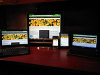Image of a responsive website on multiple devices.